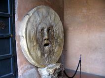 Bocca Della Verita - The Mouth of Truth. La Bocca della Verità (The Mouth of Truth) is an image, carved from Pavonazzo marble, of a man-like face, located in Royalty Free Stock Image