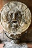 Bocca della Verita, Rome,Italy. La Bocca della Verita is an image of a man-like face, located in the portico of the church of Santa Maria in Cosmedin.The Stock Photography