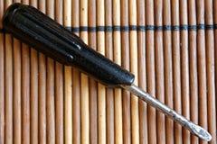 Bocca piana del cacciavite su fondo di legno, cacciavite della Piano-lama Fotografia Stock Libera da Diritti