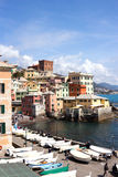 Boccadasse, Genoa - picturesque view of colorful old houses - Liguria. Genoa, Boccadasse, Italy - April 24, 2017: People enjoy the wonderful day in tiny fishing stock images