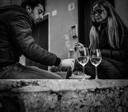 Boccadasse, Italy - April 21, 2016: Dating on young people couple . Usually the bars and restaurants are full of customers and