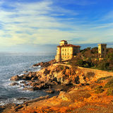 Boccale castle landmark on cliff rock and sea on warm sunset. Tu Stock Photo