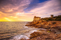 Boccale castle landmark on cliff rock and sea on warm sunset. Tu Royalty Free Stock Photo