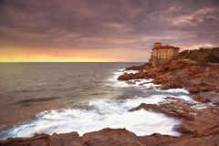 Boccale castle landmark on cliff rock and sea on warm sunset Stock Photo
