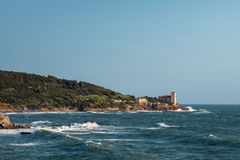 Boccale Castle, Seashore and Choppy Sea in Livorno, Italy Stock Photo