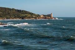 Boccale Castle, Seashore and Choppy Sea in Livorno, Italy Stock Image
