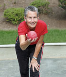 Bocce Ball. Player takes aim and gets ready to throw Bocce Ball Stock Images