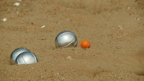 Bocce ball and jack ball in match. Slow motion stock footage