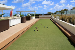 Bocce ball on an outdoor oceanfront terrace. Royalty Free Stock Images