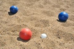 Bocce balls on a beach Stock Images