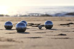 Bocce balls. On sandy beach Stock Images