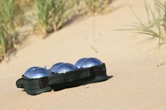 Bocce balls. On sandy beach royalty free stock image