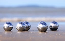 Bocce balls on a sandy beach Royalty Free Stock Photo
