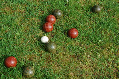 Bocci Balls. Scattered in a bright green yard Stock Photo