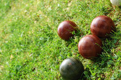 Bocci Balls. Scattered in a bright green yard Stock Image