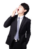Bocejo cansado do homem de negócio Imagem de Stock