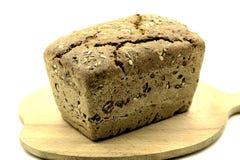 Bochenek chleb na popiół desce zdjęcie royalty free