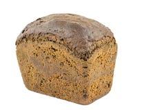 Bochenek prostacki m?ka chleb z otr?by i zbo?ami odizolowywaj?cymi na bia?ym tle obrazy royalty free