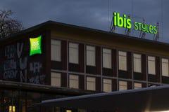 Bochum, North Rhine-Westphalia/germany - 02 11 18: ibis hotel styles sign on an building in bochum germany in the evening. Bochum, North Rhine-Westphalia/germany royalty free stock photography