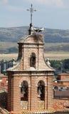 Bociana gniazdeczko na górze belltower Obraz Stock