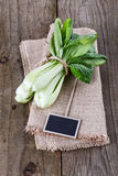 Bock Choy over rustic wooden background Royalty Free Stock Photography