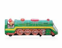 Bocznego widoku antyka zieleni zabawki pociągu cynk na białym tle, kopii przestrzeń obraz stock