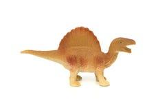 Bocznego widoku brązu spinosaurus zabawka Fotografia Royalty Free