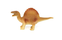 Bocznego widoku brązu spinosaurus zabawka na bielu Fotografia Royalty Free