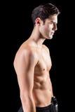 Boczny widok bokser pozycja na czarnym tle fotografia stock