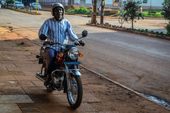 ''Boda Boda. Jinja, Uganda -September 2015 - A boda boda cyclist. The boda boda industry is the country's second highest employer, after agriculture of course Royalty Free Stock Image