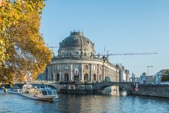 Bode Museum from Berlin and Boad on River Spree at autumn vibes stock photo