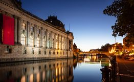 Bode museum illuminated, Spree river, museum island, Berlin, in the evening. Bode museum illuminated, on museum island in Spree river in Berlin, Germany, in the stock images