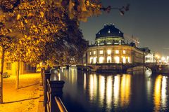 Bode museum by night and illuminated path on the Spree shore at autumn moods stock photos
