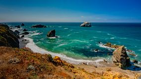 Bodega Bay coastline. Landscape view of Bodega Bay in Sonoma County in California, USA, on a typical summer day in the morning, featuring blue water and blue sky stock photography