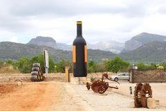 Bodega and winery with a huge bottle of wine, Mallorca, Spain. Bodega with a huge bottle of wine and barrels in the mountains, Binissalem, Mallorca (Majorca) Royalty Free Stock Photography