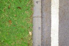 Boden des grünen Grases und des Zementes Lizenzfreie Stockfotos