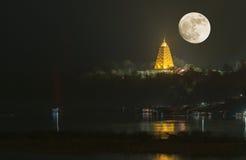 Bodh Gaya pagoda on night with full moon. The famous public place in Kanchanaburi province Stock Photos