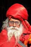 BODHNATH, NEPAL - DECEMBER 24, 2014: Portrait of an old man with a long beard at Ichangu Narayan Temple near Kathmandu Royalty Free Stock Photos