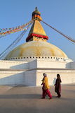 BODHNATH, NEPAL - DECEMBER 22, 2014: Two Nepalese Women at the Bodhnath Stupa near Kathmandu Royalty Free Stock Photos