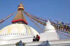BODHNATH, NEPAL - DECEMBER 23, 2014: A young Nepalese couple at the Bodhnath Stupa near Kathmandu Royalty Free Stock Image