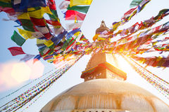 Bodhnath Stupa  with Buddha Eyes - shot against the sun. Royalty Free Stock Photo