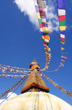 Bodhnath stupa in kathmandu. With buddha eyes and prayer flags on clear blue sky background Royalty Free Stock Photography