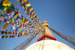 Bodhnath Stupa in Kathmandu with Buddha Eyes and prayer flags Royalty Free Stock Images