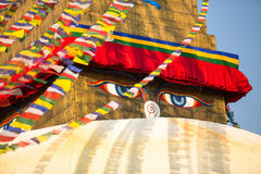 Bodhnath Stupa in Kathmandu with Buddha Eyes and prayer flags. Royalty Free Stock Images