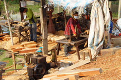 BODIA - FEB 9, 2015 - Worker shaping timber for balustrade Stock Photography