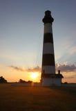 bodie海岛灯塔现出了轮廓日出 免版税图库摄影