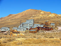 Bodie buildings. Old mining town structures against hill and blue sky royalty free stock image