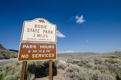 Sign welcoming visitors to Bodie State Historic park, an old gold rush mining town in the Eastern. Sierra Nevada stock photo