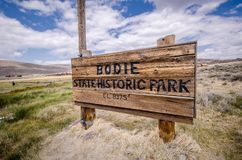 Sign welcoming visitors to Bodie State Historic park, an old gold rush mining town in the Eastern. Bodie, California: Sign welcoming visitors to Bodie State stock image
