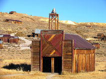 Bodie fire station. Old Bodie mining town's wooden fire station with bell stock photos